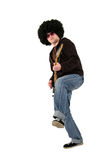 Young guitarist playing a black electrical guitar Royalty Free Stock Photography