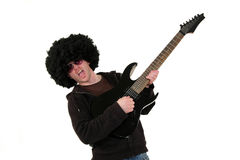 Young guitarist playing a black electrical guitar Royalty Free Stock Image