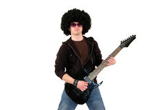 Young guitarist playing a black electrical guitar Royalty Free Stock Photo