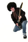 Young guitarist playing a black electrical guitar Stock Images