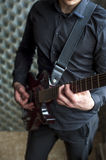 Young guitarist playing on electric guitar Royalty Free Stock Photo