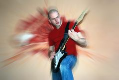 Young guitarist playing  guitar Royalty Free Stock Photo