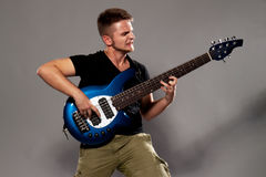 Young guitarist plays on the electric guitar Royalty Free Stock Photos
