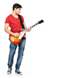 Young guitarist plays on the electric guitar Royalty Free Stock Photo