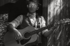 Young guitarist portrait. Old film retro effect Royalty Free Stock Images