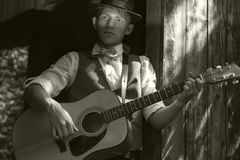 Young guitarist portrait. Old film retro effect Stock Photos