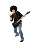 Young guitarist showing his middle finger Royalty Free Stock Photos