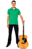 Young guitarist standing with guitar Stock Photography