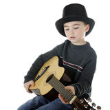 Young Guitarist in Top Hat Royalty Free Stock Image