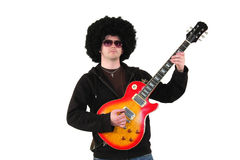 Young guitarist with a wig and sunglasses Royalty Free Stock Image