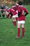 Young Guns. Rugby Youth Team, with focus on number 11 on the wing waiting for the action to start again stock photos