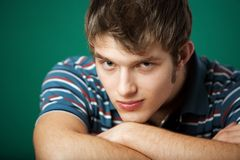 Young guy. On a green background Stock Images
