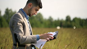 Young guy angry businessman talking on the phone stock footage
