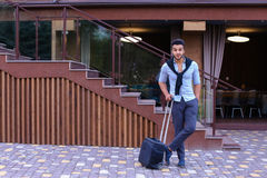Young Guy Arab Businessman Student Came go to Restaurant With Su. Arabic Muslim Young Man Coming Out of Corner and Goes With Travel Bag to Modern Restaurant Royalty Free Stock Image