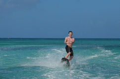 Young Guy In Aruba Riding on a Wakeboard Stock Photography