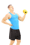 Young guy with back pain while lifting a dumbbell. Isolated on white background Stock Photography