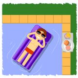 Guy in the pool on an air mattress. A young guy bathes on an air mattress in the pool Stock Image