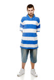 Young guy with a beard. A young guy with a beard, wearing shorts, sneakers and football shirt, isolated on a white background Royalty Free Stock Photos
