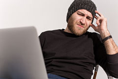 Young guy with a beard with a laptop Stock Photography