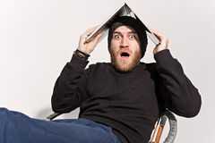 Young guy with a beard with a laptop Stock Images