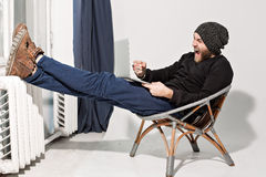 Young guy with a beard with a laptop Stock Photos