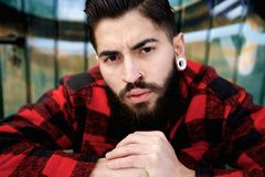 Young guy with beard and piercings Royalty Free Stock Photos