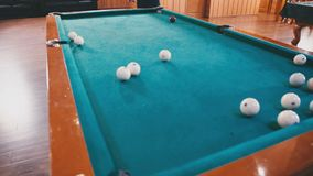 Young guy beats a cue on the ball stock footage