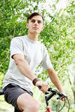 Young guy on bicycle Stock Image