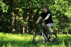 Young guy on bike royalty free stock image