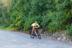 A young guy on a bike outdoors Royalty Free Stock Images