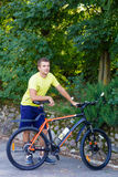 A young guy on a bike outdoors Royalty Free Stock Photography