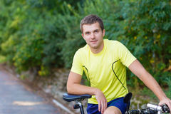 A young guy on a bike outdoors Stock Images
