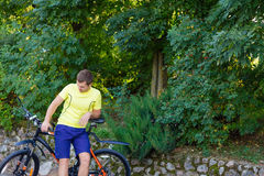 A young guy on a bike outdoors Stock Image