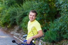 A young guy on a bike outdoors Stock Photography