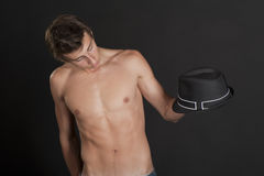 Young guy with a black hat Stock Photography