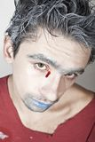 Young guy with blue lips and bloody tears Stock Images
