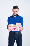 A young guy in a blue shirt with gifts Stock Photos