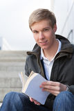Young guy with book Royalty Free Stock Photography