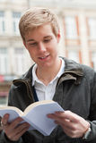 Young guy with book Stock Image