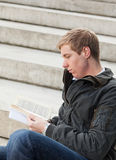 Young guy with book Royalty Free Stock Photo