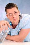 Young guy with bottle of water Royalty Free Stock Images