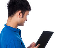 Young guy browsing on tablet device Stock Photos