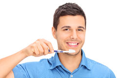 Young guy brushing his teeth Stock Photography