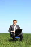 Young guy businessman. In the suit, on the field Royalty Free Stock Photos