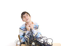 The young guy with cables Royalty Free Stock Image