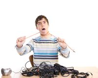 The young guy with cables isolated on a white Royalty Free Stock Photography