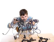 The young guy with cables isolated on a white Royalty Free Stock Images