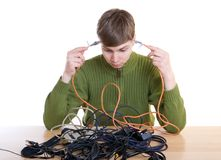 The young guy with cables isolated on a white Royalty Free Stock Photos