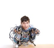 The young guy with cables isolated on a white Stock Photo