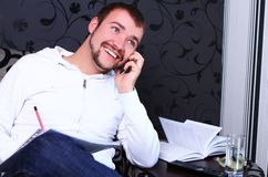 Young guy calling by phone Stock Photos